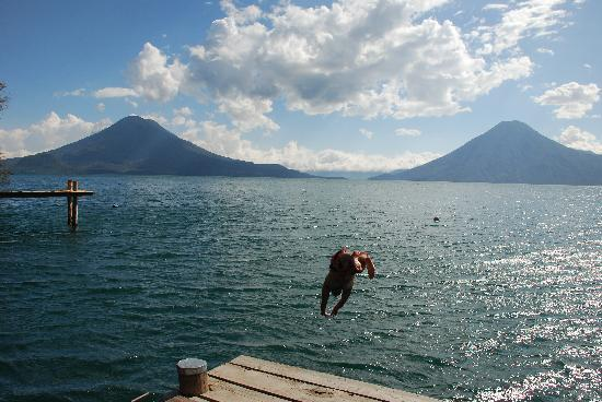 My husband diving into the lake