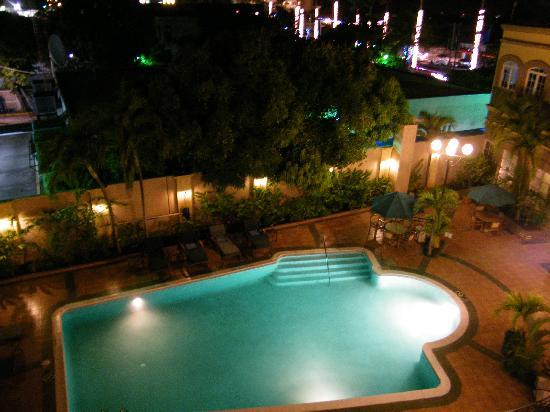 Hilton Princess Managua: The hotel pool at night - viewed from our room