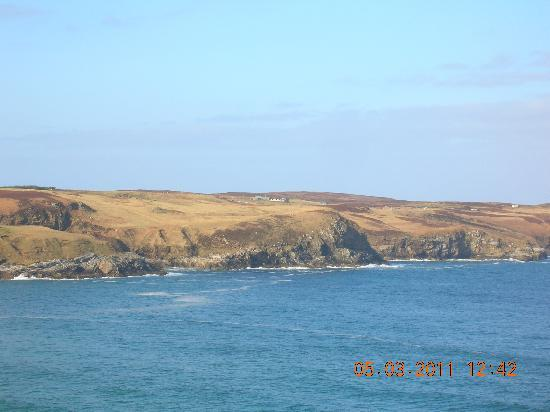 Looking across to Sharvedda and Strathy from cliffs near Baligill