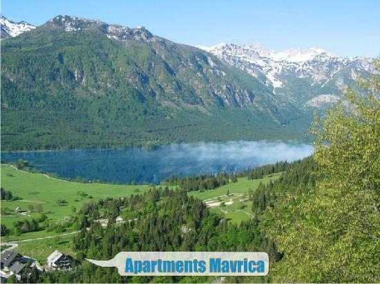 Apartments Mavrica with lake Bohinj and ski center Vogel behind