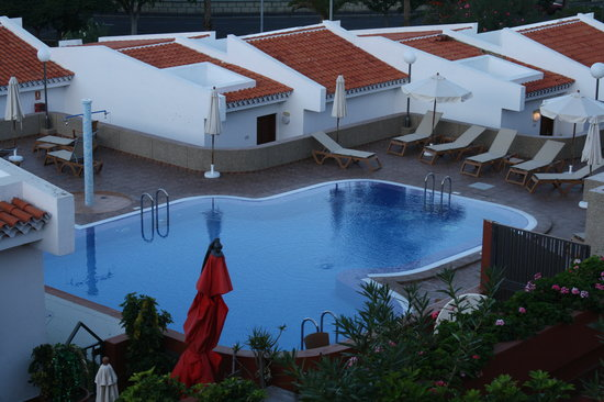Island Village Apartments : One of the pools and sunbathing zone