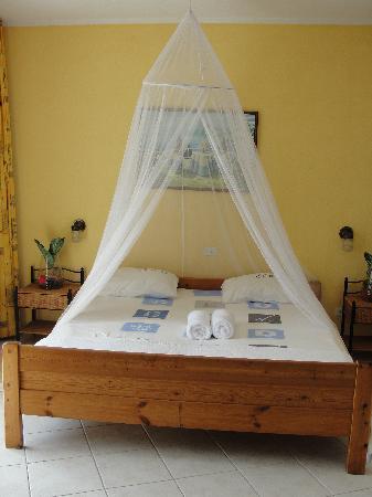 Aruba Beach Chalets : bedroom with an oceanfront balcony