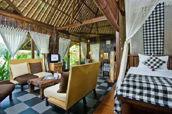 Villa Kunang Kunang: Designed for up to four guests, the bungalow is divided into two sleeping area with comfortably