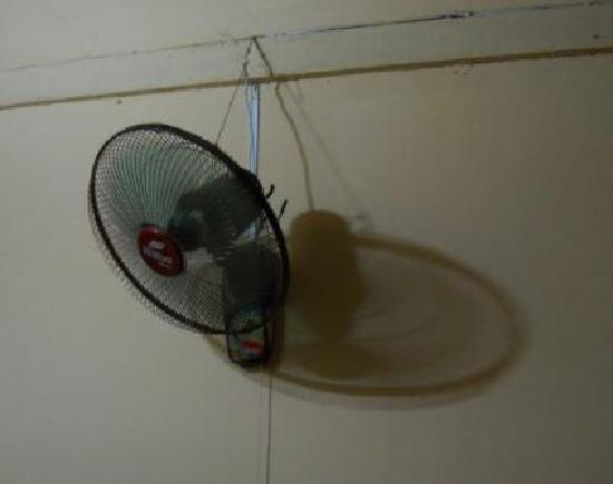 Kampot River View: Fan held up by a string.  It squealed all night.  Black dirt