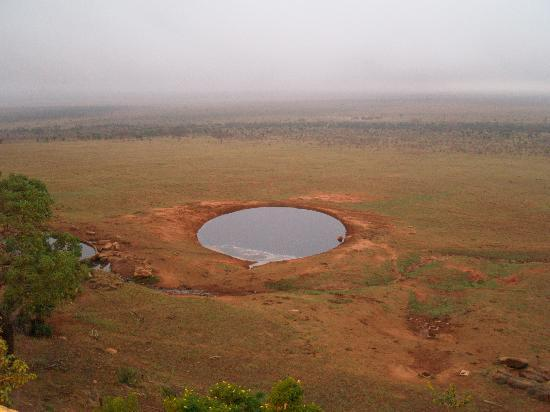 Mnarani Hotel: View from Voi safari down to watering hole