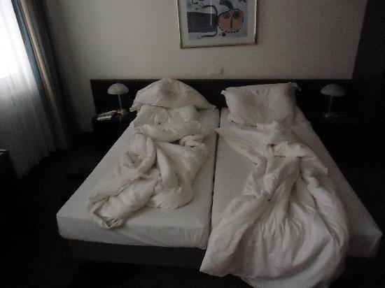 Hotel Central: The beds, each person gets their own duvet.
