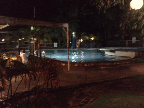 The Ritz Hotel At Garden Oases: pool at night