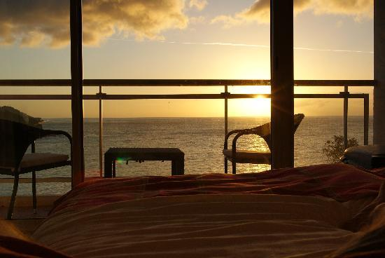 Langley Resort Hotel Fort Royal Guadeloupe: View of sunset from hotel room bed.