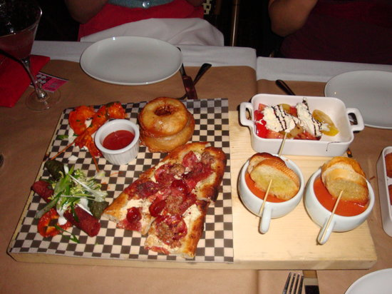 Society Dining Lounge: Onion rings, kobe beef taquitos, buffalo prawns, mini Italian pizza and the caprese salad