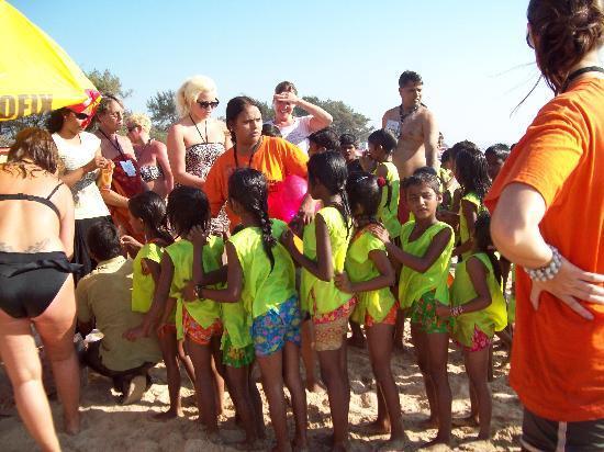 Ticlo Resorts: childrens orphanage havingday on beach