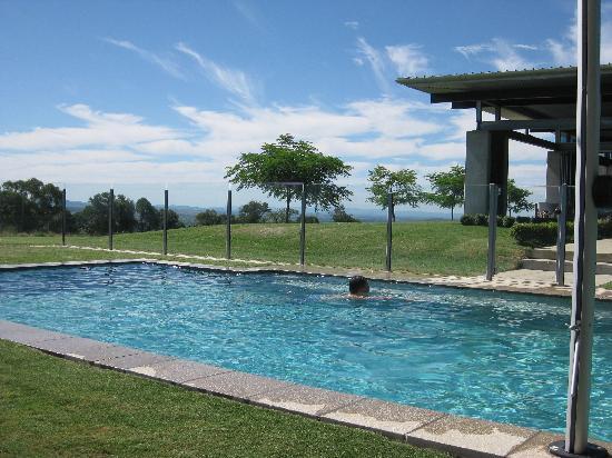 The Bunyip Scenic Rim Resort: My husband enjoying a swim in the pool