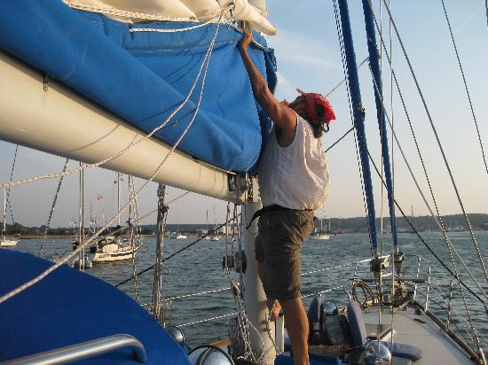 Sea Witch Sailing Charters: Capt John Lowering the main sail