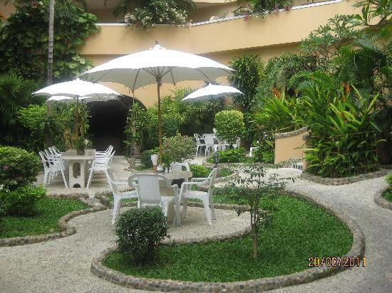 The Dining Room at Pacific Club: Garden from restaurant