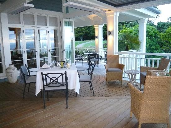 ‪‪The Lodge at Kauri Cliffs‬: Dining on porch, great views‬