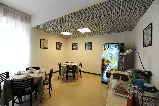 Corvetto Residence Porto Di Mare: L'area Breakfast, la giornata inizia meglio quando si inizia con un sorriso
