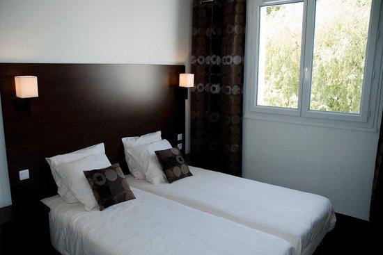 Hôtel Le Mokca : Chambre lits jumeaux