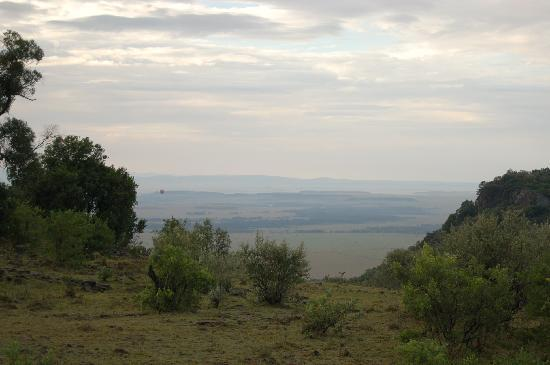 Mara West Camp: View off midrange porch.  See the hot air balloons over the Maasi Mara?