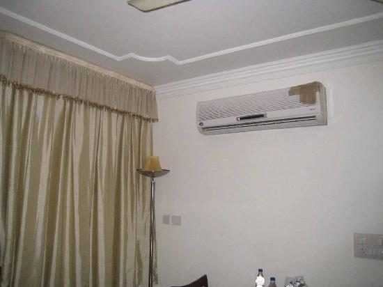 The Swiss Palms: The AC - with a remote that didn't work.