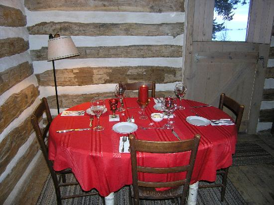 Oakland, IA: Private dining for 2 or for 8 in the log cabin.