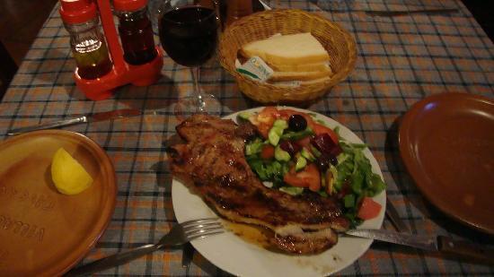 The Village Restaurant : Pork chop, salad and red wine