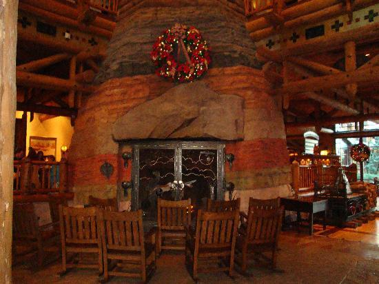 The fireplace in the lobby picture of boulder ridge for Villas wilderness lodge