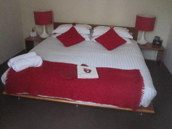 TWOFOURTWO Boutique Apartments: Main bedroom after a visit from the 'Apple Bunny'