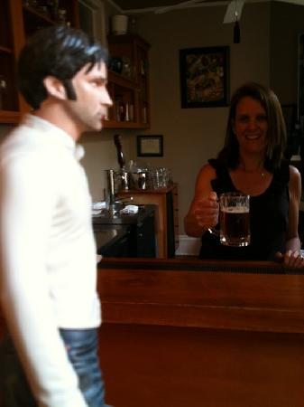 Maison Perrier: Patricia offers Bill Compton a beer during happy hour.