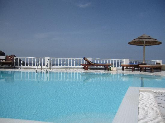 Santorini Princess: Pool that looks out on the caldera - you need a panoramic camera to catch all the views!