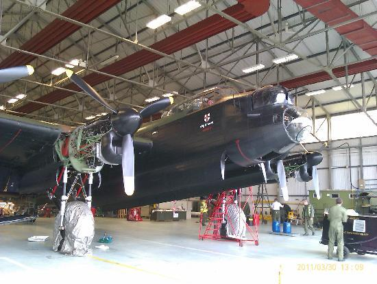 ‪‪Battle of Britain Memorial Flight Visitor Centre‬: Lancaster being serviced‬