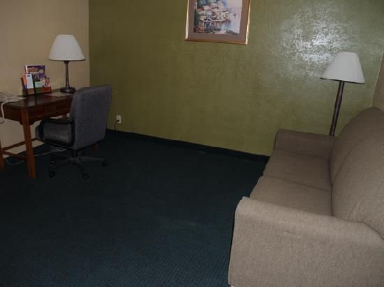 Howard Johnson Inn & Suites San Antonio Near at&T Center: In the suite: desk and fold out couch w/ bed