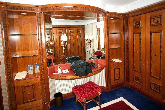 Burj Al Arab Jumeirah: The paneled dressing room includes massive closet space and a dressing table.