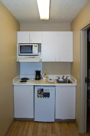 Crossland Economy Studios - Spokane - Valley: Typical kitchenette: Microwave, electric range, and mini fridge. No diswasher, but a pack of det