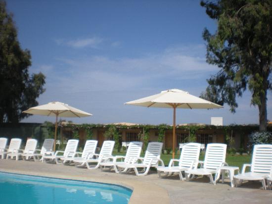 Casa Andina Standard Chincha: piscina con habitaciones