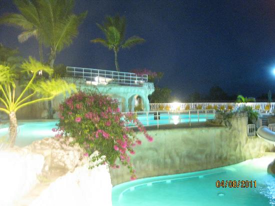 Cofresi Palm Beach & Spa Resort: Nighttime shot of the adult pool and kids pool.  Notice the waterfalls not running.