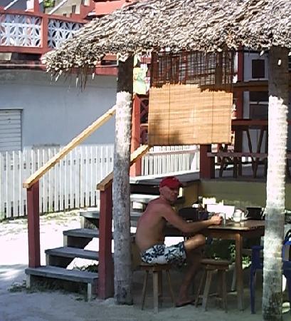 My partner eating breakfast at Amor Y Cafe.