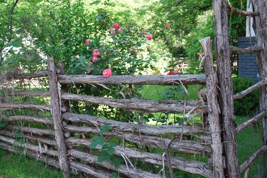 1110 Carriage House Inn: charming rustic fence on grounds of Carriage House Inn adds character