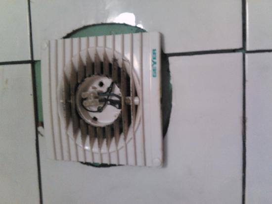 Hotel Residence: Ventilator with open curent wires in the bathroo next to the shower