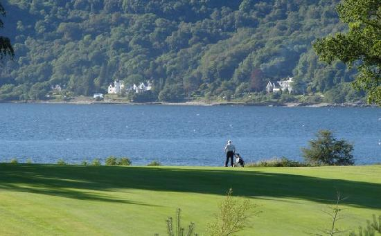 The Dragons Tooth Golf Course: A lone golfer with Loch Lhinnie in the back ground
