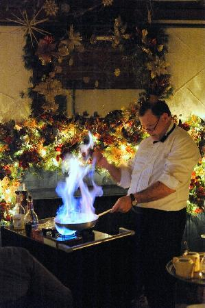 Waiter at 1785 Inn preparing Bananas Foster tableside