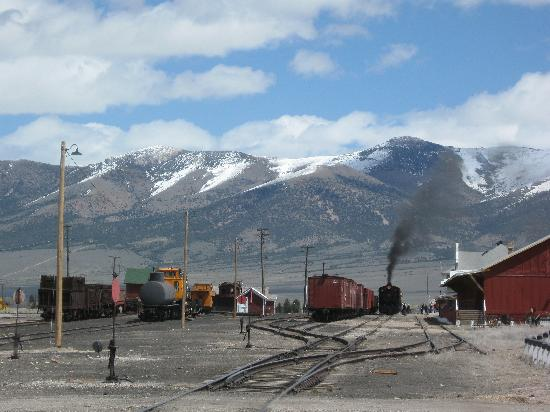 Ely, NV: View of the railyard, mountains, and steam engine