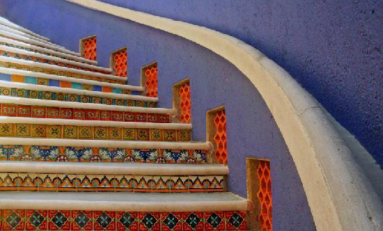 The Taj Majahual: The sweeping spiral staircase leads you to the secure oceanside vacation rental Taj Mahajual