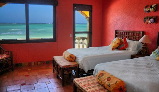 The Taj Majahual : The 'Saluta de Fruta' or 'Tribute to Fruit' bedroom brings the festive colors of local tropical