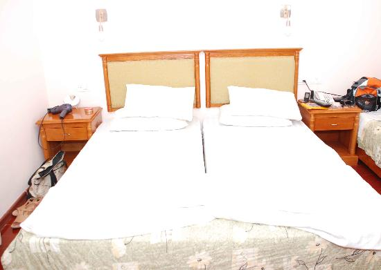 Sahara Hotel : This is a queen size bed for both of us =)