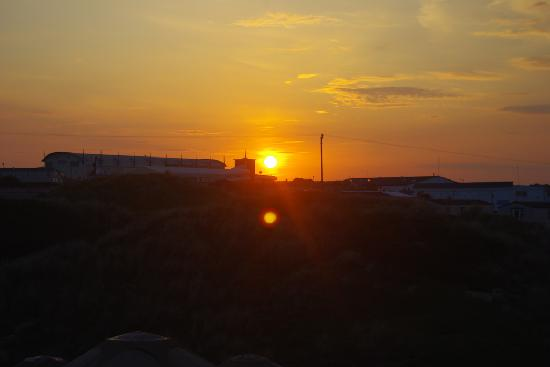 Perran Sands Holiday Park - Haven: Sunset over the main complex