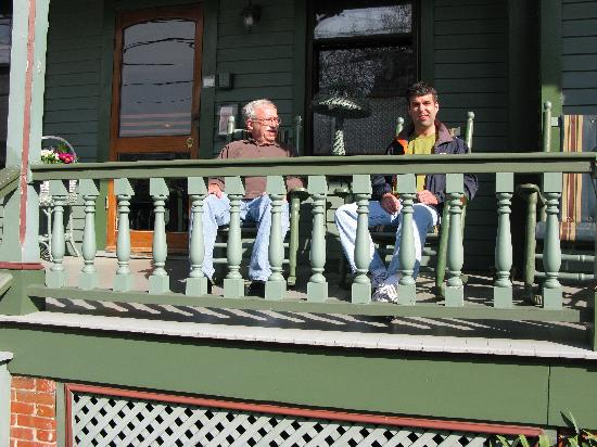 My husband and son on the front porch
