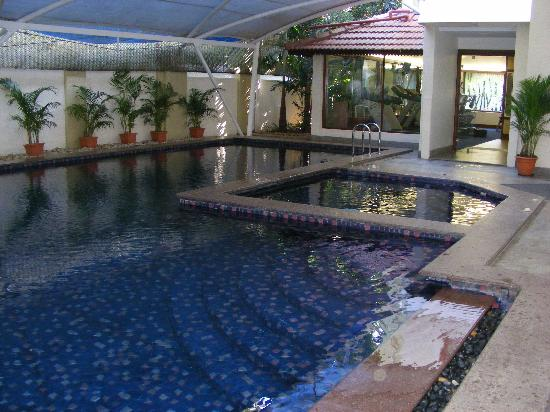 The Paul Bangalore : the swimming pool and jacuzzi near gym
