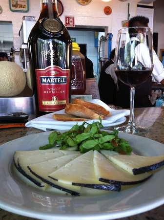 Primos: a plate of aged manchego for entry