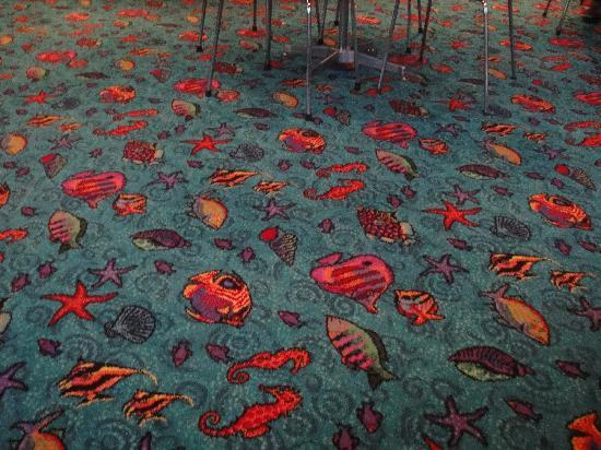 Blue Waters Hotel: The dining room carpet - guess what their speciality is!