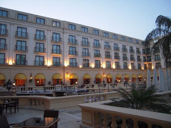 Concorde El Salam Hotel Cairo by Royal Tulip: rear of hotel at dusk