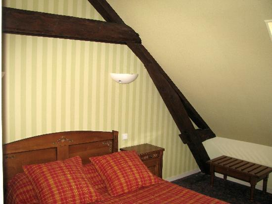 Autun, France: Our bed and 1/2 timbering